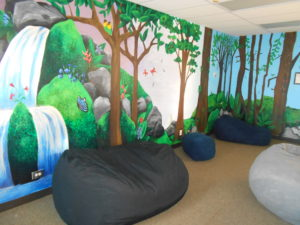 Chill room with painted walls and bean chairs for student to chill