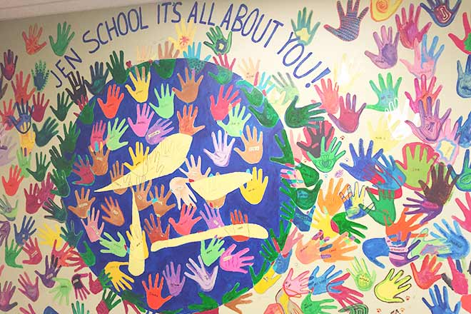 """Jen School's """"Wall of Hands"""" depicts the lasting impression each and every student, staff, and animal that comes through the building leaves on the school."""