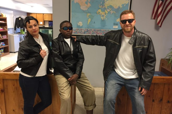 Room 401 team and student dressed as greasers from The Outsiders for Spirit Week